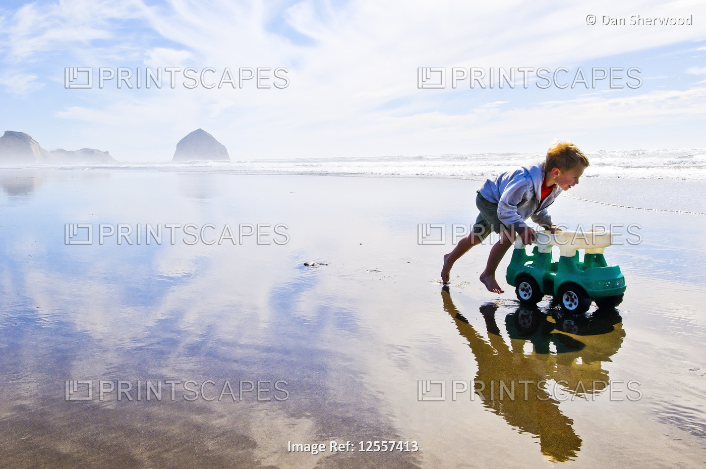 Boy Playing in the wet sand at the Oregon Coast - Oregon